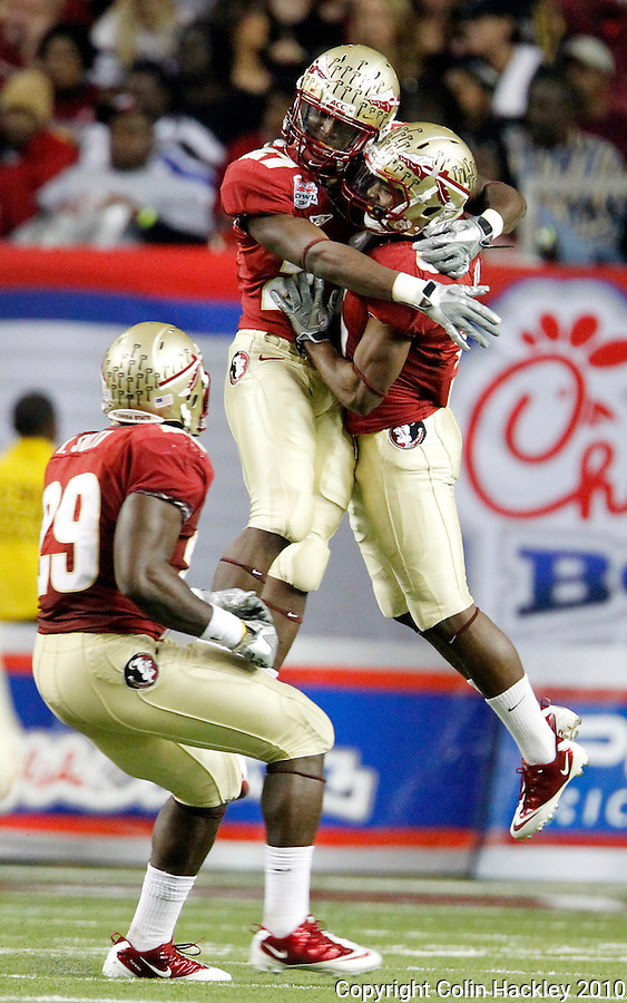 ATLANTA, AG 12/31/10-FSU-SC FB10 CH-Florida State's Xavier Rhodes, left, celebrates his interception with Greg Reid as Kendall Smith, lower left, watches during first half action against South Carolina Friday at the Chick-fil-A Bowl in Atlanta..COLIN HACKLEY PHOTO