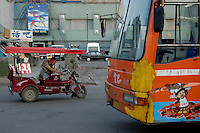 Taxi driver waiting in his motor tricycle, Datong, Shanxi, China.