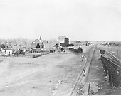 View of Antonito yard, taken from water tank, looking north.  The coal trestle is at the right edge of the photo. Siding to Mill (2 story building).<br /> D&amp;RG  Antonito, CO  Taken by Joyce, W. D. - ca. 1910-1920