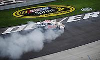 May 31, 2008; Dover, DE, USA; Nascar Nationwide Series driver Denny Hamlin celebrates after winning the Heluva Good 200 at the Dover International Speedway. Mandatory Credit: Mark J. Rebilas-US PRESSWIRE