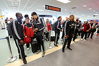 Wednesday 07 August 2013<br /> Pictured L-R: Footballers Roland Lamah, Ki Sung Yueng and Ashley Williams queuing to check in at Cardiff Airport.<br /> Re: Swansea City FC travelling to Sweden for their Europa League 3rd Qualifying Round, Second Leg game against Malmo.