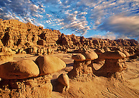 "Close up of rock formations in Goblin Valley State Park, Utah Clouds have been added to the sky. Please caption as ""Photo Illustration"""