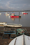Fishing boats and other small craft at moorings. Small fishing and sailing hamlet of Felixstowe Ferry at the mouth of the River Deben, Suffolk, England