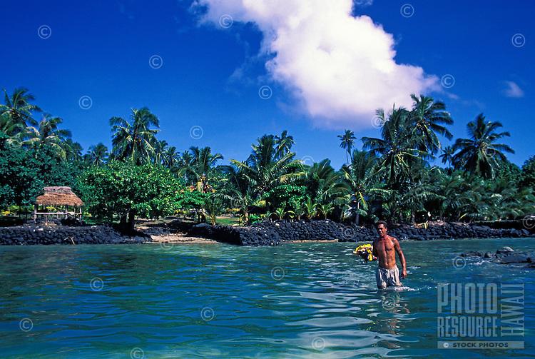 Samoan wades off Manono Island, Samoa