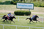 August 10, 2019 : Our Bay B Ruth, ridden by Florent Geroux, leads the field on the stretch for home on the way to win an undercard race during Arlington Million Day at Arlington International Racecourse in Arlington Heights, Illinois. Jon Durr/Eclipse Sportswire/CSM