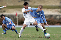 SMU's David Chun (10) tugs UNC's Ben Hunter (11) off the ball. Southern Methodist University defeated the University of North Carolina 3-2 in double overtime at Fetzer Field in Chapel Hill, North Carolina, Saturday, December 3, 2005.