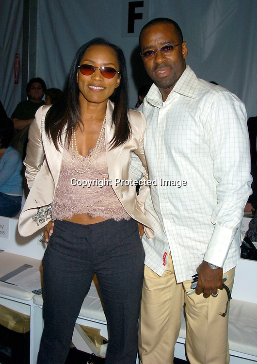 Angela Bassett and husband Courtney Vance..at The Pamella Roland Spring 2005 Fashion Show on ..September 13, 2004 at the Tents. ..Photo by Robin Platzer, Twin Images