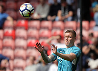 Alfie Mawson of Swansea City practices headers prior to the Premier League match between Southampton and Swansea City at the St Mary's Stadium, Southampton, England, UK. Saturday 12 August 2017
