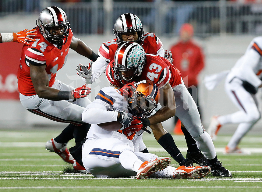 Ohio State Buckeyes linebacker Darron Lee (43), defensive back Vonn Bell (11) and linebacker Curtis Grant (14) stop Illinois Fighting Illini quarterback Aaron Bailey (15) during the second quarter of the NCAA football game at Ohio Stadium on Nov. 1, 2014. (Adam Cairns / The Columbus Dispatch)