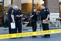 NWA Democrat-Gazette/BEN GOFF @NWABENGOFF<br /> Officers from the Rogers Police Department investigate a shooting Tuesday, June 11, 2019, at the Freddy's Frozen Custard & Steakburgers in Rogers. Witnesses reported a male was shot in the leg during an altercation with another male in the parking lot, according to a press release from the department. The individual with the gunshot wound drove himself to Mercy Hospital and the shooter fled the scene, according to the release.