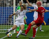 GRENOBLE, FRANCE - JUNE 15: Rebekah Stott #6 of the New Zealand National Team clears the ball as Sophie Schmidt #13 of the Canadian National Team closes during a game between New Zealand and Canada at Stade des Alpes on June 15, 2019 in Grenoble, France.