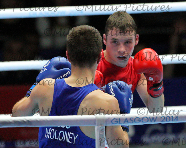 Reece McFadden of Team Scotland in the red vest against Andrew Moloney of Team Australia in the Men's Flyweight Semi Final bout  in the Boxing for the 20th Commonwealth Games, Glasgow 2014 at the Scottish Exhibition and Conference Centre, Glasgow on 1.8.14.