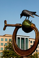 The Apple and the Clamp, public artwork created by Peter Woytuk, is located in the Ballantyne Corporate Park in Charlotte, NC. The Simmons Building is located in the background. Ballantyne, a suburb of Charlotte NC, is located near the South Carolina border. The 2,000-acre mixed-use development was created by land developer Howard C. Smokey Bissell.