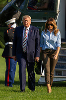United States President Donald J. Trump and first lady Melania Trump hold hands as they walk on the South Lawn of the White House in Washington, D.C., U.S., following a weekend at the Trump National Golf Club in Bedminster, New Jersey, on Sunday, August 4, 2019.    <br /> CAP/ADM/CNP/TK<br /> ©TK/CNP/ADM/Capital Pictures