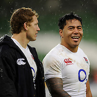 Manu Tuilagi of England (right) smiles with team mate Billy Twelvetrees of England after winning the RBS 6 Nations match between Ireland and England at the Aviva Stadium, Dublin on Sunday 10 February 2013 (Photo by Rob Munro)