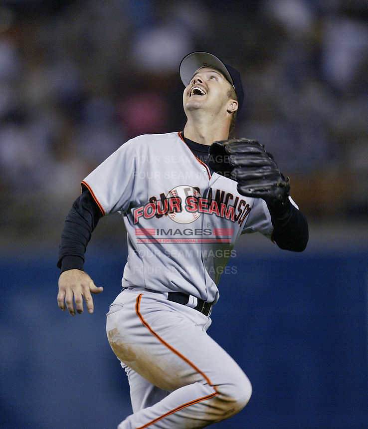 Jeff Kent of the San Francisco Giants chases a fly ball during a 2002 MLB season game against the Los Angeles Dodgers at Dodger Stadium, in Los Angeles, California. (Larry Goren/Four Seam Images)