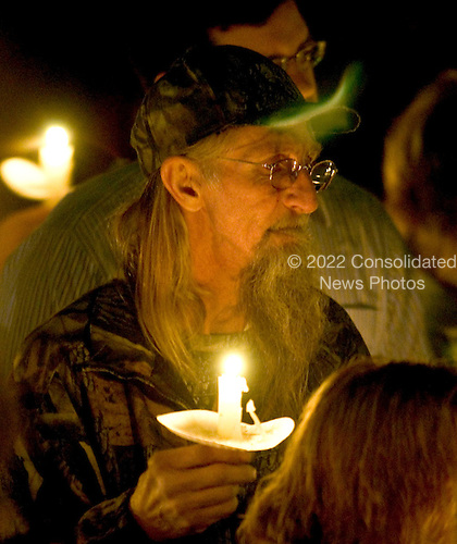 Sago, WVa - January 4, 2006 -- Bill Tenney, a former coal miner, attends a candlelight vigil at the Sago Baptist Church in Sago, West Virginia on January 4, 2006.  The vigil was to show support for the families of the miners who perished in the coal mine explosion early in the morning of January 2, 2006..Credit: Ron Sachs / CNP