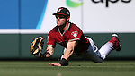Diamondbacks&rsquo; Evan Marzilli makes a diving catch during a spring training game against the Dodgers in Scottsdale, Ariz., on Friday, March 18, 2016. <br />Photo by Cathleen Allison
