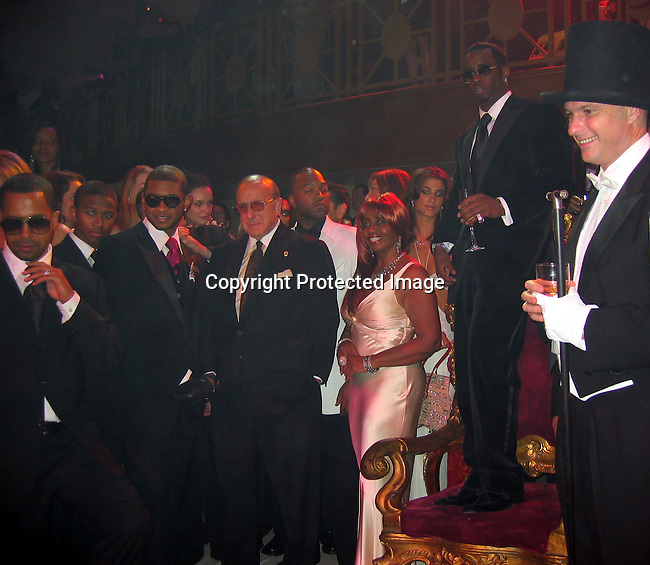 Usher, Clive Davis, Janice Combs, Sean P. Diddy Combs &amp; Cipriani looking at the girls dancing that just came out of a cake<br />Sean P. Diddy Combs Celebrates his 35th birthday by giving himself a Royal Birthday Ball<br />Cipriani Wall Street<br />New York, NY, USA<br />Thursday, November 04, 2004<br />Photo By Celebrityvibe.com/Photovibe.com, New York, USA, Phone 212 410 5354, email:sales@celebrityvibe.com
