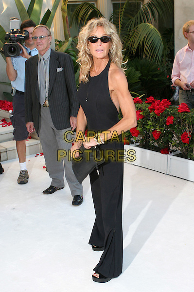 FARRAH FAWCETT.Remembering Rodney: Celebration of the One Year Anniversary of the Passing of Comic Legend Rodney Dangerfield held at the home of Joan Dangerfield, West Hollywood, California..October 5th, 2005.Photo Credit: Zach Lipp/AdMedia/Capital Pictures.Ref: ZL/ADM/CAP.full length sunglasses shades black top trousers skinny thin arm.www.capitalpictures.com.sales@capitalpictures.com.© Capital Pictures.