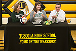 March 1, 2017- Tuscola, IL- Maddie Allen smiles and looks over to friends and teammates after signing signs her letter of intent to continue her volleyball career with the Parkland Cobras as mother Tonya Allen and father Brad Allen applaud. [Photo: Douglas Cottle]