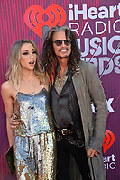 LOS ANGELES, CA. March 14, 2019: Steven Tyler & Aimee Preston at the 2019 iHeartRadio Music Awards at the Microsoft Theatre.<br /> Picture: Paul Smith/Featureflash