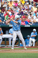 North Carolina Tar Heels designated hitter Landon Lassiter #12 bats during Game 3 of the 2013 Men's College World Series between the North Carolina State Wolfpack and North Carolina Tar Heels at TD Ameritrade Park on June 16, 2013 in Omaha, Nebraska. The Wolfpack defeated the Tar Heels 8-1. (Brace Hemmelgarn/Four Seam Images)