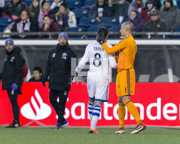 Foxborough, Massachusetts - April 6, 2018: First half action. In a Major League Soccer (MLS) match, New England Revolution (blue/white) vs Montreal Impact (white), at Gillette Stadium.<br /> Red Card: Saphir Taider