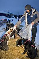 Robert Sorlie Snacks His Dogs @ Kaltag Chkpt AK 2005 Iditarod