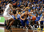 SIOUX FALLS, SD - NOVEMBER 26:  Cole Gentry #10 from South Dakota State University looks to drive past Desonta Bradford #11 from East Tennessee State University during their game at the Sanford Pentagon Saturday evening in Sioux Falls. (Photo by Dave Eggen/Inertia)
