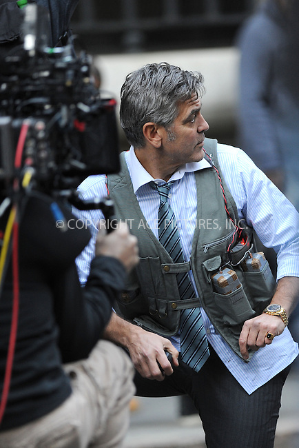 WWW.ACEPIXS.COM<br /> April 11, 2015 New York City<br /> <br /> George Clooney on the film set of 'Money Monster' in the Financial District of Manhattan on April 11, 2015 in New York City. <br /> <br /> Please byline: Kristin Callahan/AcePictures<br /> <br /> ACEPIXS.COM<br /> <br /> Tel: (646) 769 0430<br /> e-mail: info@acepixs.com<br /> web: http://www.acepixs.com