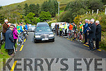 The hearse carrying the remains of the Legendary Iron Man Mike Murphy arrives at Sugreana Cemetery, just outside Cahersiveen led by a Guard of Honor by South Kerry Cyclists and the Renard GAA Club.