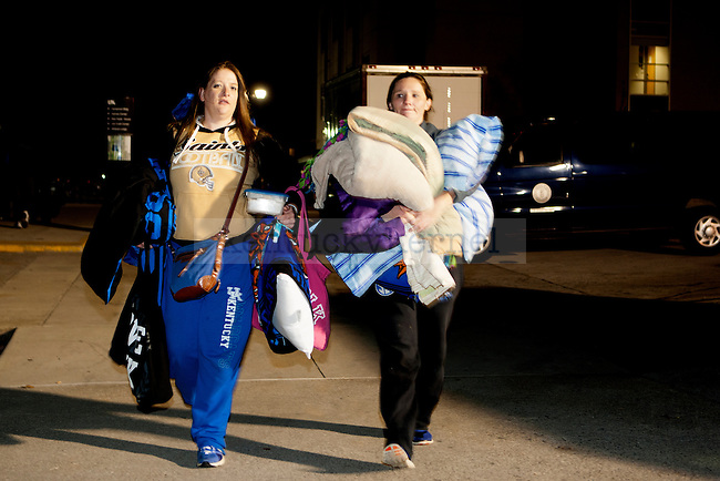 Fans carry pillows and blankets to their tents during Big Blue Madness campout in Lexington, Ky.,on Wednesday, September 17, 2014. Photo by Michael Reaves | Staff