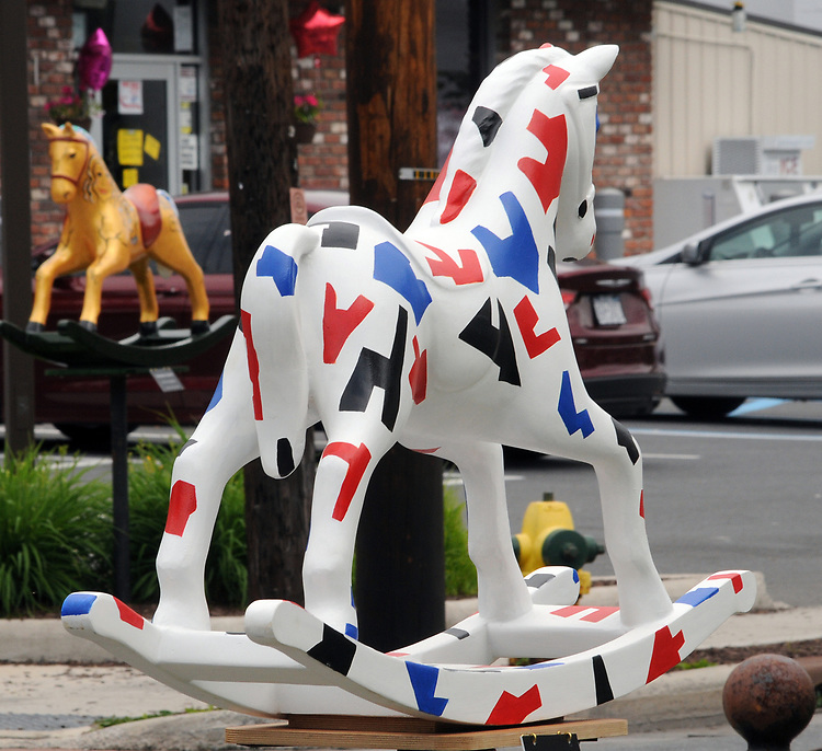 """A view of """"American Rocker #1"""" created by Edward Berkise, on Main Street, one of the """"Rockin' Around Saugerties"""" theme Statues on display throughout the Village of Saugerties, NY, on Friday, June 9, 2017. Photo by Jim Peppler. Copyright/Jim Peppler-2017."""
