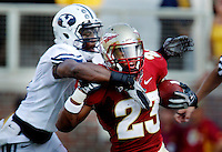 TALLAHASSEE, FL 9/18/10-FSU-BYU FB10 CH-Florida State's Chris Thompson is collared by Brigham Young's Greg Reid during a second half action run Saturday at Doak Campbell Stadium in Tallahassee. The Seminoles beat the Cougars 34-10..COLIN HACKLEY PHOTO