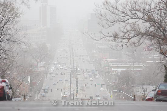 Trent Nelson  |  The Salt Lake Tribune.Salt Lake City - Looking down 4th south, Heavy winds filled the valley air with dust Tuesday, March 30, 2010.