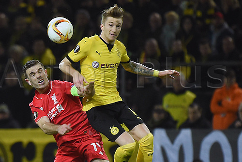 07.04.2016. Dortmund, Germany. Europa League quarterfinal. Borussia Dortmund versus Liverpool FC at the Signal Iduna Park Dortmund.   Jordan Henderson (FC Liverpool) beaten to the ball by Marco Reus (Borussia Dortmund)