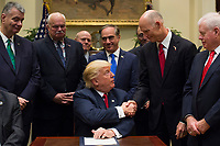 United States President Donald Trump shakes hands with Governor Rick Scott (Republican of Florida after signing S. 544 the Veterans Choice Program Extension and Improvement Act in the Roosevelt Room at the White House in Washington, DC on April 19,2017. Photo Credit: Molly Riley/CNP/AdMedia