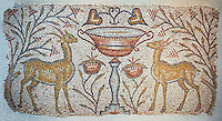 Roman mosaic of two Gazelles facing inwards either side of a vase, Eastern Mediterranean, the beginning of the 6th century AD. The mosaic design is typical of  church  floors in front of the choir. The choice of gazelles is rare though and indicates a local flavour to the content. Inv 3673, The Louvre Museum, Paris