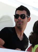MIAMI BEACH, FL - MARCH 14: Micheal Yo and Joe Jonas attends Victorias Secret Pink Nation Hosts Spring Break at The Shelborne on March 14, 2012 in Miami Beach, Florida. (photo by: MPI10/MediaPunch Inc.)