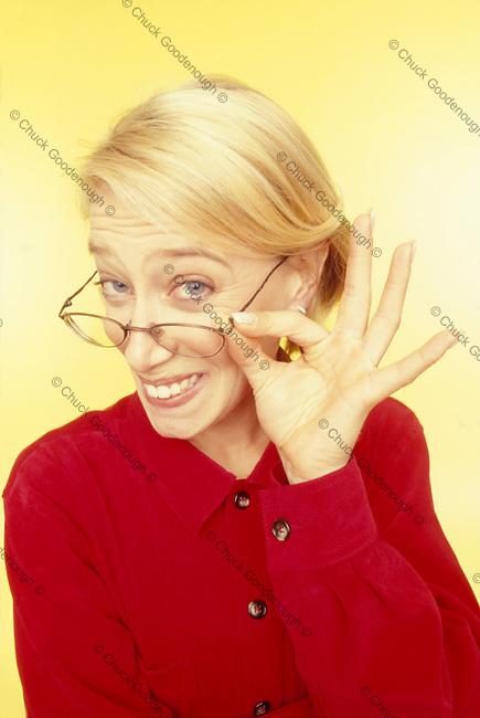 Stock photo of a nerdy blond woman with a funny grin expression.