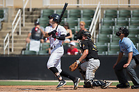Zach Remillard (8) of the Kannapolis Intimidators follows through on his swing against the West Virginia Power at Kannapolis Intimidators Stadium on June 18, 2017 in Kannapolis, North Carolina.  The Intimidators defeated the Power 5-3 to win the South Atlantic League Northern Division first half title.  It is the first trip to the playoffs for the Intimidators since 2009.  (Brian Westerholt/Four Seam Images)