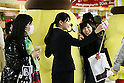 Shinjuku station commuters squeeze and take a selfie with Sanrio's character Pom Pom Purin or Purin plush dolls displayed along in the Tokyo Metro Promenade on March 8, 2016, Tokyo, Japan. 11 of the huge cuddly characters will be displayed in an underground passage of Shinjuku Station until March 13, as a part of the celebrations for the 20th Birthday of Pom Pom Purin. Sanrio is a Japanese company established in 1963, which has created over 400 cute characters, including the worldwide known Hello Kitty. (Photo by Rodrigo Reyes Marin/AFLO)