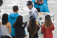 American Brett Simpson makes his way to shore after defeating So.African Jordy Smith during the final day of the 2010 US Open of Surfing in Huntington Beach, California on August 8, 2010.