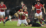 Cardiff, WALES - November 24:.Autumn International.Wales v New Zealand.Aaron Smith and Israel Dagg haul down Alex Cuthbert..24.11.12..©Steve Pope - Sportingwales
