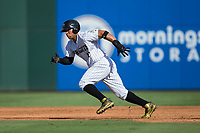 Yoan Moncada (10) of the Charlotte Knights takes off for second base during the game against the Gwinnett Braves at BB&T BallPark on July 16, 2017 in Charlotte, North Carolina.  The Knights defeated the Braves 5-4.  (Brian Westerholt/Four Seam Images)