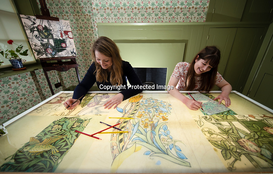 29/05/15<br /> <br /> Kim Jones and Alice Johnson using the interactive table in the Living Artist's Studio.<br /> <br /> Morris & Co. Inspired by Nature at Standen House and Garden, the National Trust's Arts and Craft House in East Grinstead, West Sussex delves in to the World of Morris & Co. Discover how repeating patterns of flowers and birds were chosen for the designs and the value that Morris placed on the revival of traditional skill. 1 Jun - 10 Nov 2019.<br /> <br /> All Rights Reserved: F Stop Press Ltd. +44(0)1335 418365   +44 (0)7765 242650 www.fstoppress.com