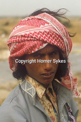 Bedouin man scavenge for stuff where the Israeli settlement of Yamit was.  <br /> <br /> Yamit Israel 1982. Yamit was an Israeli settlement established from the end of the 1967 Six-Day War, in the northern part of the Sinai Peninsula south of the Gaza Strip. The settlement was handed over to Egypt in 1982 as part of the terms of the 1979 Egypt&ndash;Israel Peace Treaty. When it became clear to residents that Yamit's days were numbered, and most accepted compensation and evacuated within two years. A minority of residents who chose to stay were joined by nationalist supporters, who moved in to boost their numbers.  The town was pulled down and families relocated.