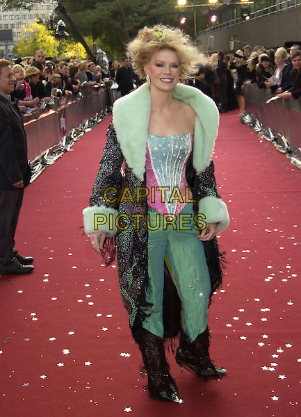 "CINDY JACKSON.ITV's ""The Celebrity Awards"".London 26 September 2004.full length, fashion disaster, green trousers, fur trim collar, coat, tassles, pink corset top.www.capitalpictures.com.sales@capitalpictures.com.©Capital Pictures"