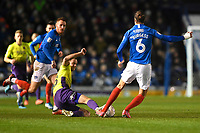 Alex Fisher of Exeter City tackles Christian Burgess of Portsmouth during Portsmouth vs Exeter City, Leasing.com Trophy Football at Fratton Park on 18th February 2020